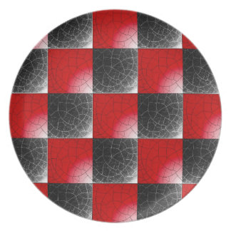 Textured red and black checkerboard dinner plate