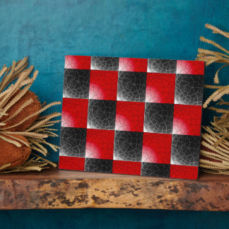 Textured red and black checkerboard plaque