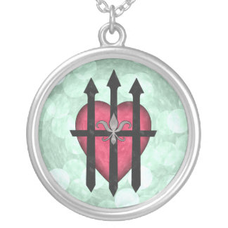 Textured red guarded heart on pale green necklaces