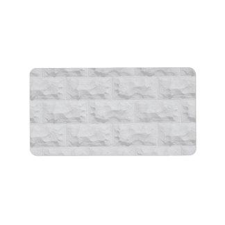 Textured white brick wall address label