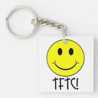 TFTC con el llavero sonriente de Geocaching de la