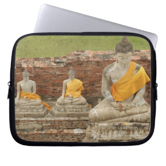 Thailand, Ayutthaya. Statues of sitting buddhas Laptop Sleeve
