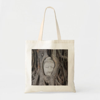 Thailand Head of Buddha surrounded by trees Tote Bag