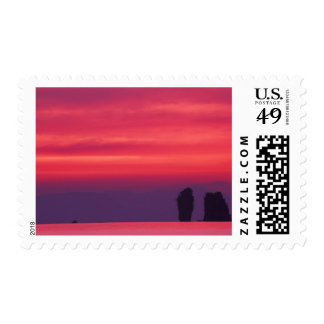 Thailand, Phang Nga Bay. Pink sky reflected in Postage