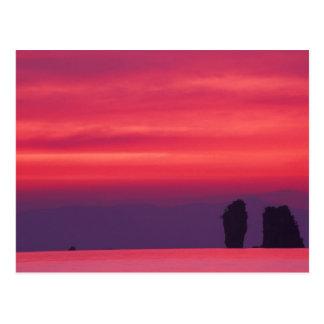 Thailand, Phang Nga Bay. Pink sky reflected in Postcard