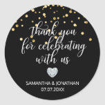 "THANK YOU for Celebrating BLACK Gold Wedding Classic Round Sticker<br><div class=""desc"">Lovely  personalized wedding stickers/labels for your gift favors. Little faux diamond heart to add a little sparkle and touch of class. Gold confetti. Wording: Thank you for celebrating with us. These thank you wedding sticker templates can be edited as you like.</div>"