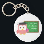 "Thank you, Teacher Appreciation Day, Cute Pink Owl Keychain<br><div class=""desc"">Express your thanks to your teacher for being such a great teacher with this cute key chain. The design has a pink owl wearing a professor hat and a purple book in her wing. The green chalkboard has text on it which reads &quot;Thank you&quot; and &quot;For being such a great...</div>"