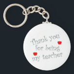 "Thank you teacher keychain<br><div class=""desc"">Thank your teacher for a great year with this extra special &quot;thank you&quot;.  Customize to create a very special end of the year gift.</div>"