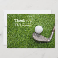 Thank you with golf ball with iron on green grass