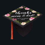 """Thanks Mom &amp; Dad   Custom School and Class Year Graduation Cap Topper<br><div class=""""desc"""">Cute personalized grad cap topper features your school and class year with &quot;thanks mom and dad!&quot; or your message of choice,  in white brush script lettering on a black background adorned with pink watercolor flowers and green foliage.</div>"""