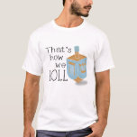 "That&#39;s how we roll T-Shirt<br><div class=""desc"">Special Hanukkah T-shirt with a Deidrel in blue and gold with the message:  &quot;That&#39;s how we roll&quot;.</div>"