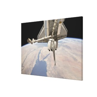 The aft section of the docked space shuttle canvas print