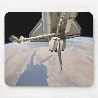 The aft section of the docked space shuttle mouse pad