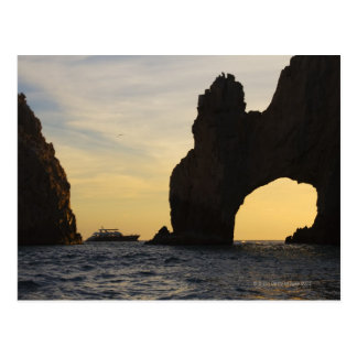 The Arch (El Arco) at Dusk with a Tour Boat in Postcard