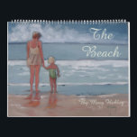 """The Beach Surf Sand Sun Calendar<br><div class=""""desc"""">This beach calendar is all about playing in the sand and the waves. The images are all about kids playing at the seashore,  with sandy sandcastles,  seashells,  and sunshine. Children at the shore are jumping in the waves,  walking along the sandy shore,  and enjoying basking in the sunshine.</div>"""