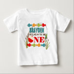 """The Big One Fishing Theme Boys First Birthday Baby T-Shirt<br><div class=""""desc"""">A colorful fishing themed first birthday shirt to help celebrate &#39;The Big One&#39;. Pops of red,  green,  orange,  and blue fish and gear provide a colorful contrast to the distressed wood background.  Clipart &#169;MyClipArtStore: http://www.myclipartstore.com</div>"""