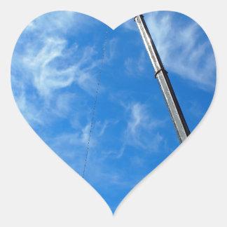 The boom of the crane heart sticker