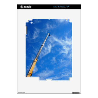 The boom of the crane on a diagonal against a blue decal for iPad 2