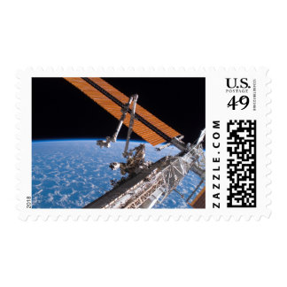 The Canadarm2 and solar array panel wings Postage