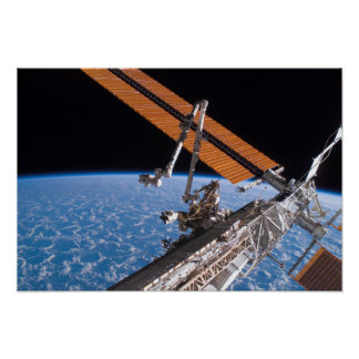 The Canadarm2 and solar array panel wings Poster
