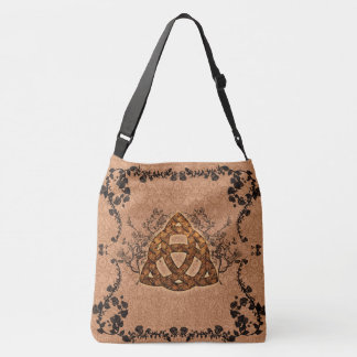 The celtic sign with roses crossbody bag