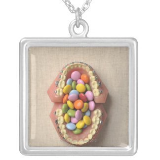 The chocolate served in the dental model silver plated necklace