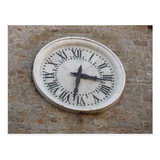 The clock on the facade of the Palazzo dei Priori Postcard