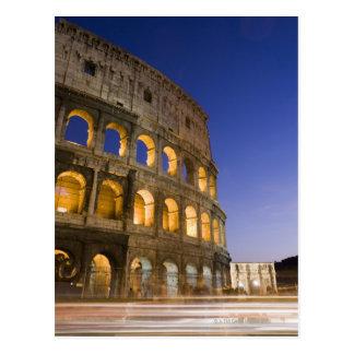 the Colosseum ampitheatre illuminated at night Postcard