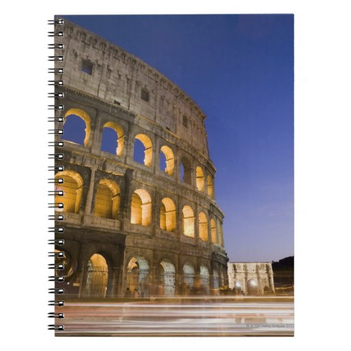 the Colosseum ampitheatre illuminated at night Spiral Notebooks