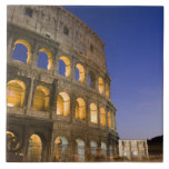 the Colosseum ampitheatre illuminated at night Tile