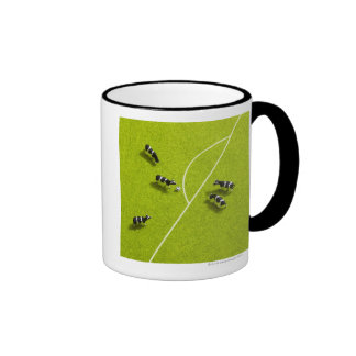 The cows playing soccer coffee mugs