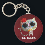 "The Day of The Dead Cute Cat Keychain<br><div class=""desc"">This is White Cat with sugar skull makeup. It&#39;s cute and according to Mexican traditions,  this make up is the preparation for Dia de Los Muertos. Like every Dia de Los Muertos art in Party Monster Store,  it is cute and sweet. Perfect design for gifts for cat lovers.</div>"