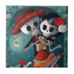 "The Day of The Dead Skeleton Lovers Tile<br><div class=""desc"">Piece of Day of The Dead art with Couple of Skeletons in love. During Mexican holiday of Dia de Los Muertos, everyone celebrate - there is lots of dancing and singing. These skeletons are in the middle of their passionate dance, among flowers and sugar skulls under the shining moon. For...</div>"