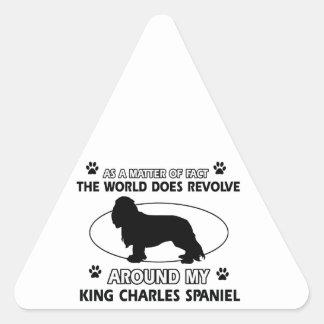 The dog revolves around my king charles spaniel triangle sticker
