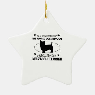 The dog revolves around my norwich terrier ceramic ornament