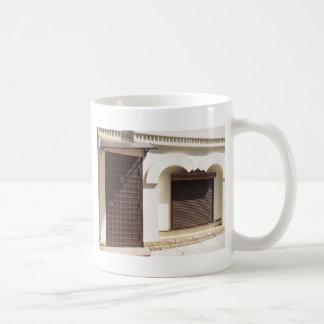 The facade of a small house coffee mug
