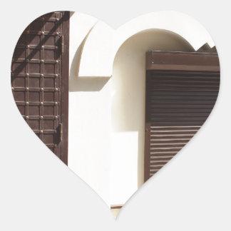 The facade of a small house heart sticker