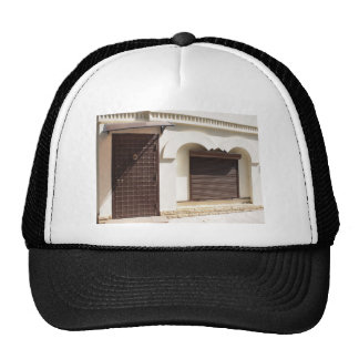 The facade of a small house trucker hat