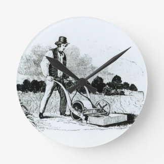 The first lawnmower (engraving) (b/w photo) round clock