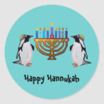 """The Frozen Chosen Hannukah Classic Round Sticker<br><div class=""""desc"""">Graphic illustration of penguins enjoying the Hannukah menorah lights.  Celebrate the miracles of Chanukah all eight nights!</div>"""