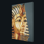 "The funerary mask of Tutankhamun Canvas Print<br><div class=""desc"">Egyptian 18th Dynasty&#39;s The funerary mask of Tutankhamun (c.1370-1352 BC) New Kingdom, c.1336-1327 BC (gold inlaid with semi-precious stones) (detail of 228800) located at the Egyptian National Museum, Cairo, Egypt. The The funerary mask of Tutankhamun (c.1370-1352 BC) New Kingdom, c.1336-1327 BC (gold inlaid with semi-precious stones) (detail of 228800) was...</div>"