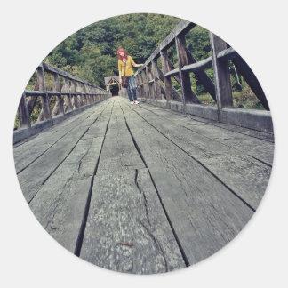 The girl on the bridge classic round sticker
