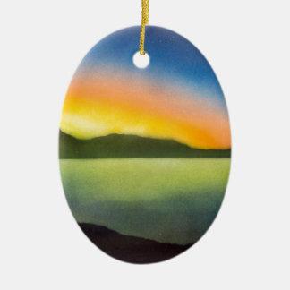 The glow of a setting sun ceramic ornament