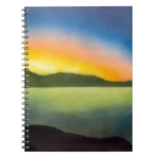 The glow of a setting sun spiral notebook
