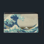 """The Great Wave off Kanagawa Wristlet Purse<br><div class=""""desc"""">An ukiyo-e woodblock print by Japanese artist Hokusai,  published sometime between 1830 and 1833 in the late Edo period as the first print in Hokusai&#39;s series Thirty-six Views of Mount Fuji. It is Hokusai&#39;s most famous work,  and one of the best recognized works of Japanese art in the world.</div>"""