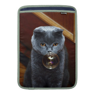 The grey cat British breed with large yellow eyes MacBook Sleeves