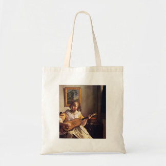 The guitar player by Johannes Vermeer Tote Bags