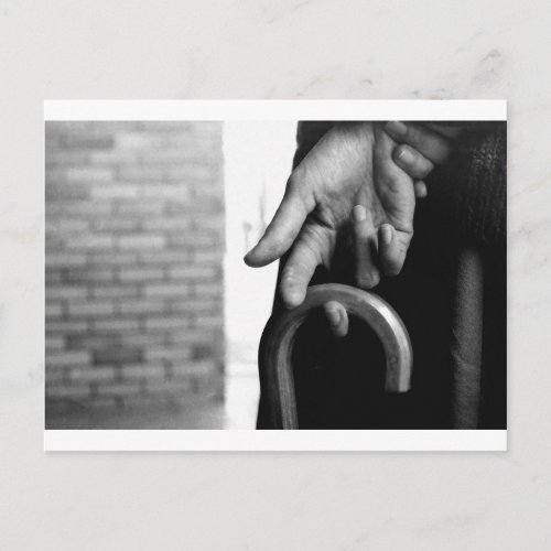 The hand holding an umbrella postcard