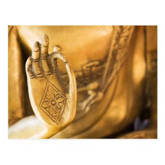 The hand of the golden ZEN Buddha Postcard