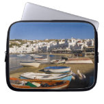 The harbor town with colorful fishing boats laptop sleeves